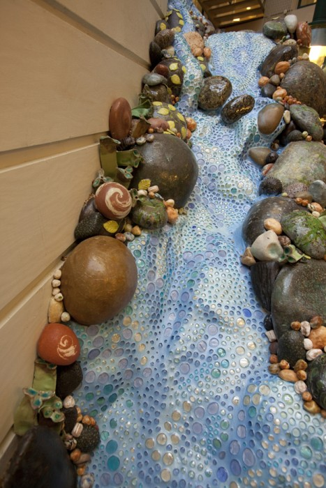 """St. Louis Childrens Hospital Cafe: """"Rocks and Pebbles"""" 2013 Detail of Waterfall. Glass Pebbles, Grout, Handbuilt ceramic and glaze rocks."""