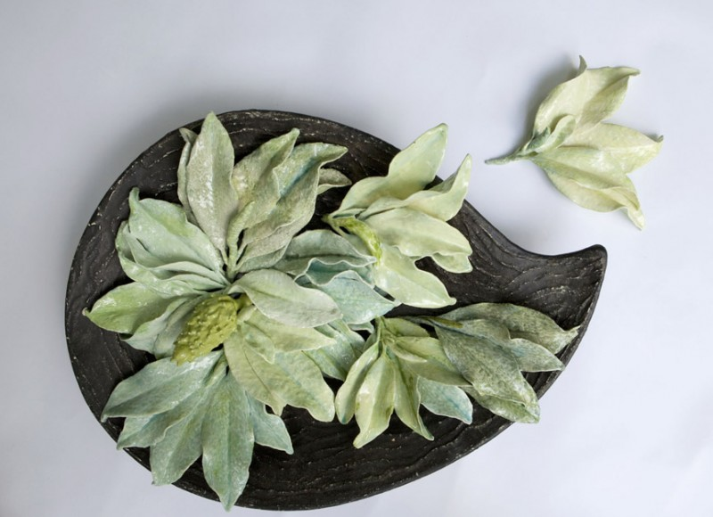 """Magnolia"" 30""x 20"" x 3"". The leaves and pods are actual natural objects that have been dipped in clay slip and glaze and then fired, which allows each object to become a cast of itself."