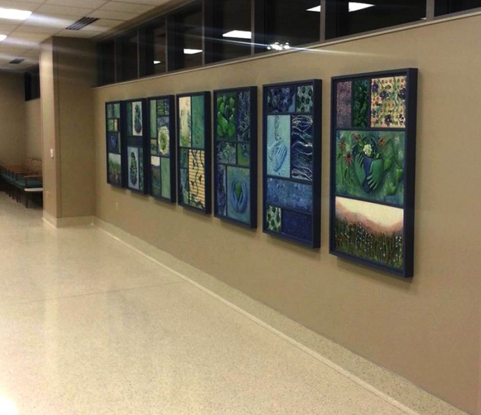 """""""The Nature of Hands"""", The New St.Mary's Hospital in Jefferson City. Ceramic tile and wood framed collages. 2014.The title of this work, the Nature of Hands is inspired by two meanings of the word nature.   The first definition of nature-- the phenomena of the physical world collectively, including plants, animals, the landscape- is presented here as an expanse of nature inspired by the Central Missouri country side.  The flora and fauna in the artwork are symbolic and abstract.  They represent biological life forms from both the micro-scale and the human-scale worlds. In this piece, you can discover small healthy cells, abundant seeds, new leaves, vines, flying fauna, and multiple water symbols which are just a few of the many other natural elements contained within the artwork.  The second definition of nature is 'the essence of a thing'.  This definition of nature is represented by the pair of hands within each panel.   The hands are stylized, and not meant to be any certain individual's hands.  They are inclusive symbols of all the hospital employees hands--gloved and working together to create a healing environment.   The hands are joining, offering, caring, praying, protecting, cleansing, and giving-- critical life giving activities that are performed hundreds of times each day in this hospital."""