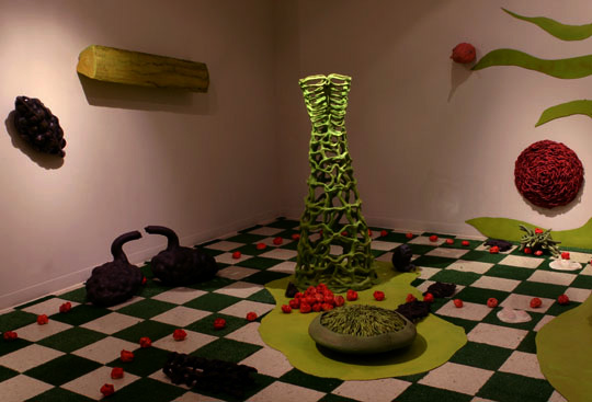 "Detail"" ""Retreat"",  The topiary piece shown is titled ""American Beauty"".  61"" x 23"" x 10""."