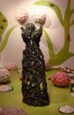 "Detail: ""Retreat""  The topiary piece shown, titled: ""Topiary Wife"",  59"" x 12"" x 10"".  Ceramic and Glaze."