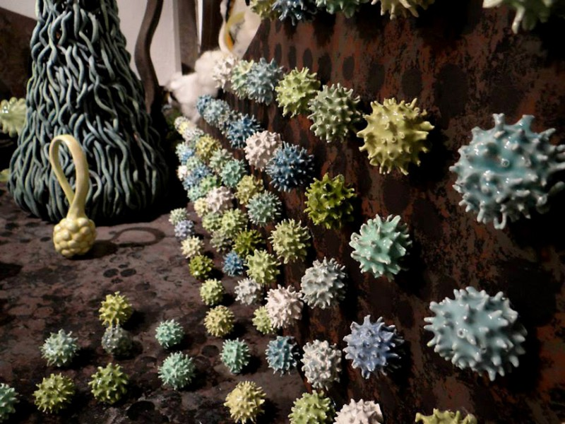 "Detail:""Gathering Landscape"" shown are actual gum balls which were found objects dipped in clay slip and glaze and fired.  They are mounted on  acrylic painted wood, with ceramic objects and wool."